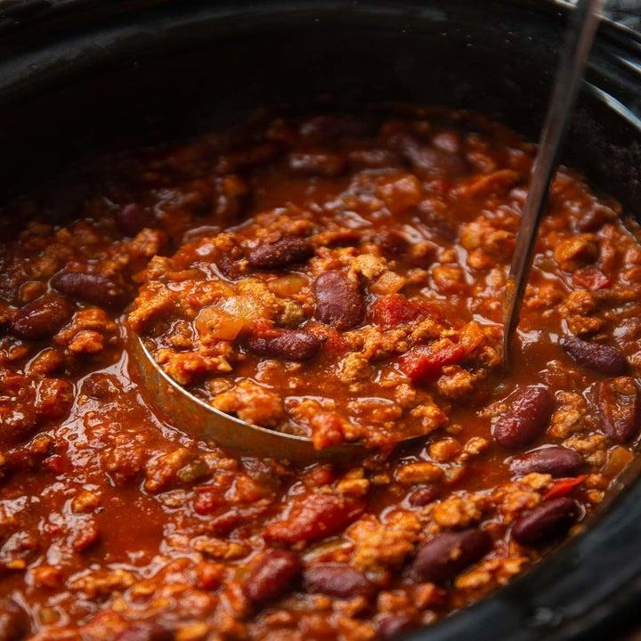 A slow cooker full of turkey chili.