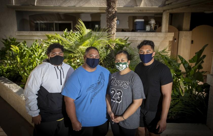 """The Ili family poses outside their Long Beach condo. From left are Taylor, 22; Aoga, 46; Lina, 46; and Pele, 26. Taylor, Aoga and Lina were all hospitalized with the coronavirus in a matter of days. <span class=""""copyright"""">(Allen J. Schaben / Los Angeles Times)</span>"""