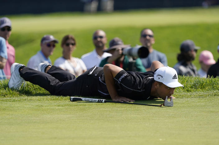 Xander Schauffele lines up his shot on the 11th green during the first round of the U.S. Open Golf Championship, Thursday, June 17, 2021, at Torrey Pines Golf Course in San Diego. (AP Photo/Marcio Jose Sanchez)
