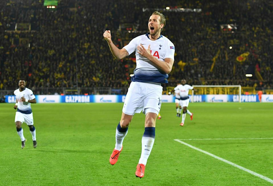 Tottenham forward Harry Kane celebrates after scoring the opening goal during the Champions League round of 16, 2nd leg, soccer match between Borussia Dortmund and Tottenham Hotspur at the BVB stadium in Dortmund, Germany, Tuesday, March 5, 2019. (Bernd Thissen/dpa via AP)