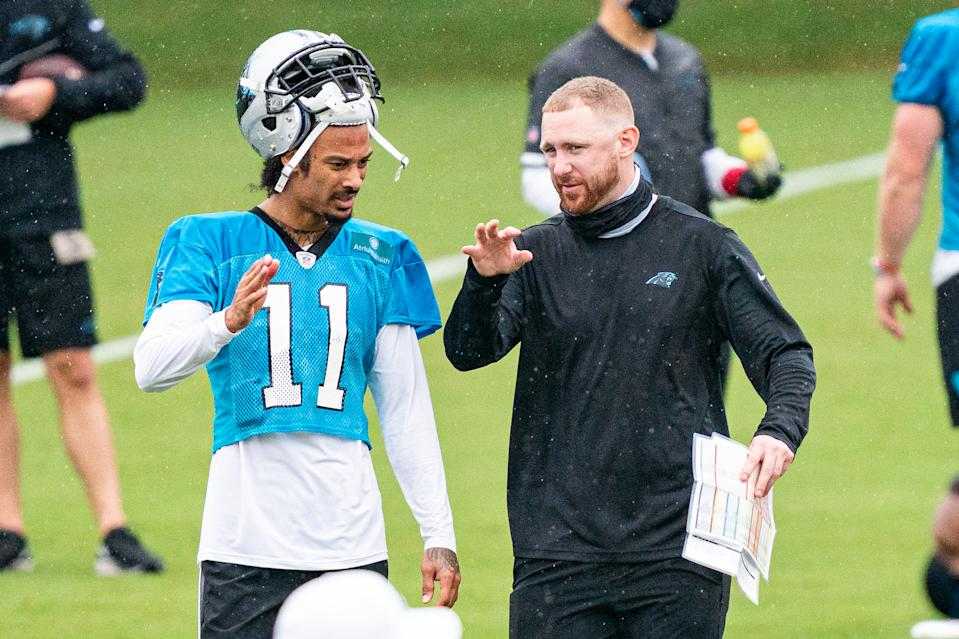 Carolina Panthers offensive coordinator Joe Brady talks to Robby Anderson during an offseason training camp practice on Aug. 21. (Jacob Kupferman/Getty Images)