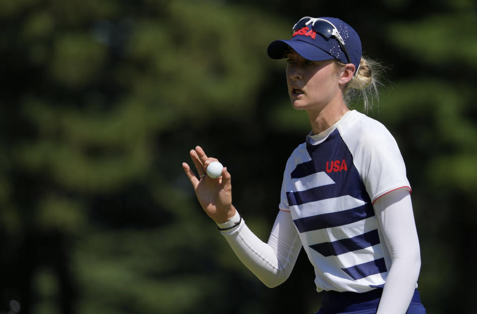 Nelly Korda, of the United States, gestures after making a birdie putt on the 16th green during the second round of the women's golf event at the 2020 Summer Olympics, Thursday, Aug. 5, 2021, at the Kasumigaseki Country Club in Kawagoe, Japan. (AP Photo/Andy Wong)