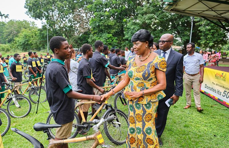 "Hon. Elizabeth K. T. Sackey (center), Deputy Regional Minister of Greater Accra and Mr. Carl Nelson (second from right), COO, Ghana Investment Promotion Centre, congratulating bamboo bicycle recipients, recently, at the African Bicycle Contribution Foundation's ""500th Bicycle"" event, in Accra."