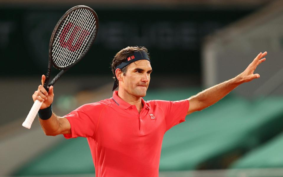 Roger Federer of Switzerland celebrates after winning match point during his Men's Singles third-round match against Dominik Koepfer of Germany on day seven of the French Open at Roland Garros in Paris - Julian Finney/Getty Images