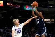 DePaul guard Dee Bekelja (23) defends against Connecticut guard Christyn Williams (13) during the second half of an NCAA college basketball game on Monday, Dec. 16, 2019. in Chicago, Ill. (AP Photo/Matt Marton)