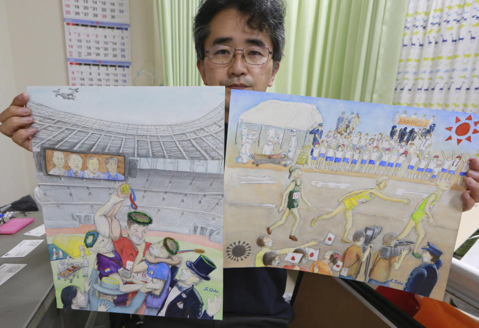 Doctor Sachihiro Ochi holds his work during an interview with the Associated Press in Yokohama near Tokyo, Tuesday, June 15, 2021. Ochi, artist who joined the anti-Olympic exhibition, also social worker and doctor in a clinic near Yokohama Stadium, which will host Olympic baseball and softball games. He says Yokohama and Tokyo, have hardened their policies on the homeless because of the Olympics. Public spaces that were once open are now covered with colored cones and obstacles to keep away the homeless, he said. (AP Photo/Koji Sasahara)