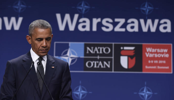 <p>President Barack Obama listens to Polish President Andrzej Duda offering condolences before making statements following their meeting at PGE National Stadium in Warsaw, Poland, July 8, 2016. Obama is in Warsaw to attend the NATO Summit. (Photo: Susan Walsh/AP) </p>