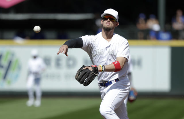 Toronto Blue Jays second baseman Cavan Biggio throws to first for the out after fielding a grounder from Seattle Mariners' Dee Gordon in the third inning of a baseball game Sunday, Aug. 25, 2019, in Seattle. (AP Photo/Elaine Thompson)