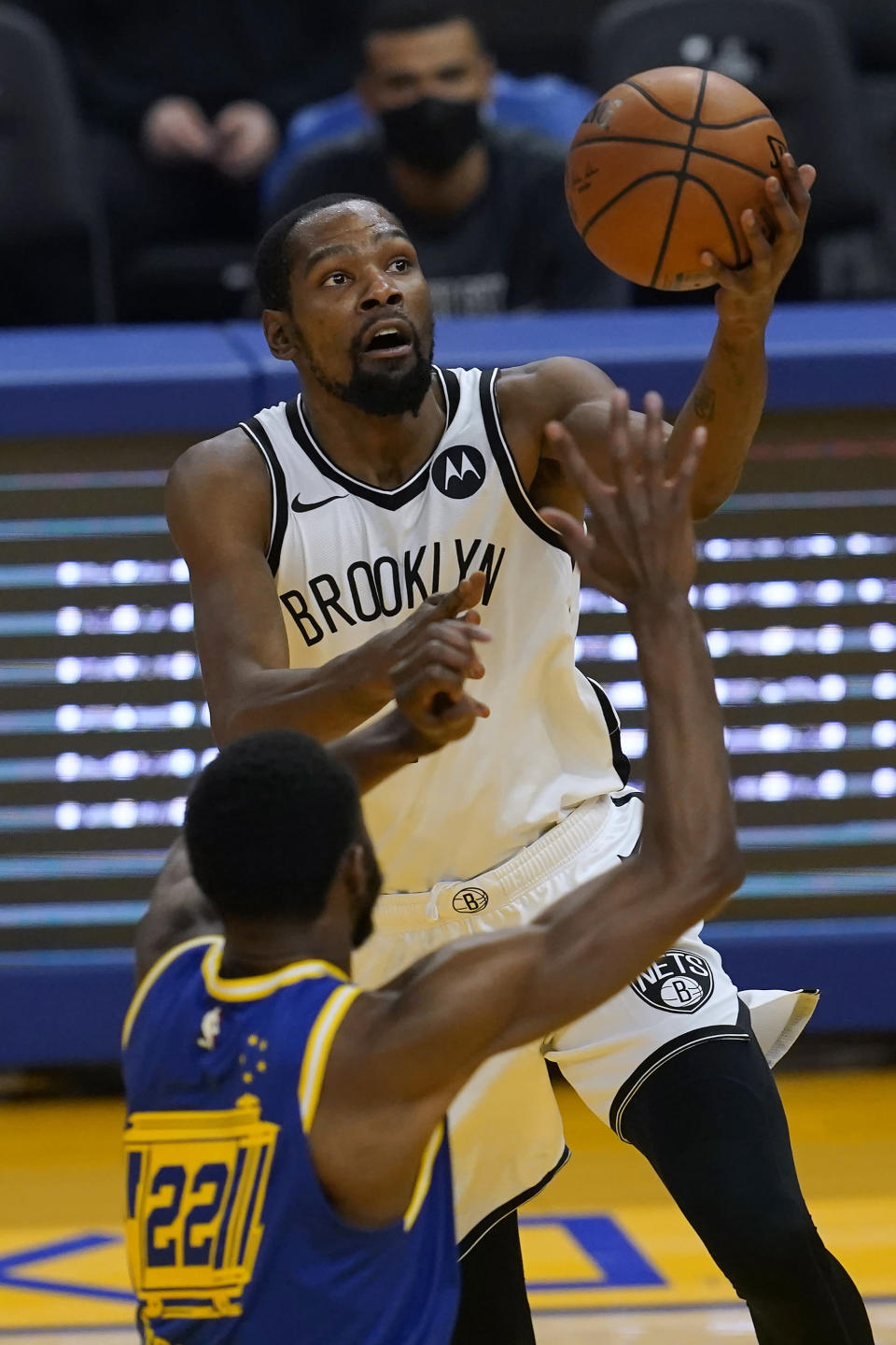 Brooklyn Nets forward Kevin Durant, top, shoots asGolden State Warriors forward Andrew Wiggins defends during the first half of an NBA basketball game in San Francisco, Saturday, Feb. 13, 2021. (AP Photo/Jeff Chiu)