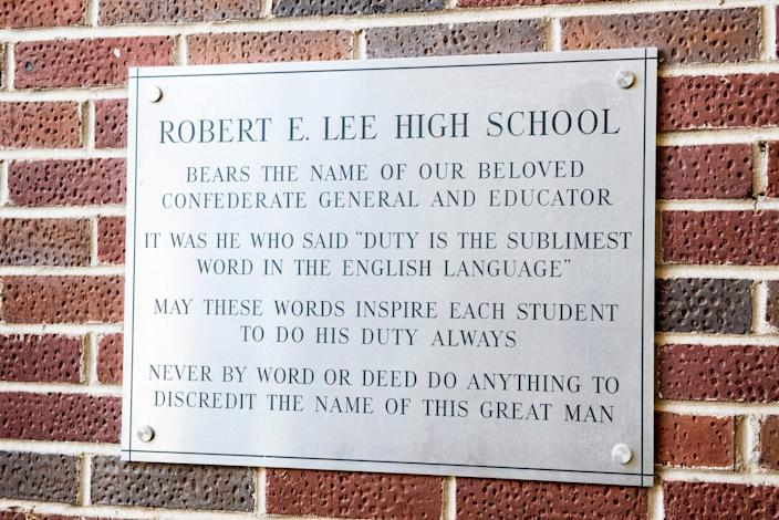 A plaque hangs just inside the entrance of Robert E. Lee High School in Montgomery, Ala., on Thursday, June 18, 2020.