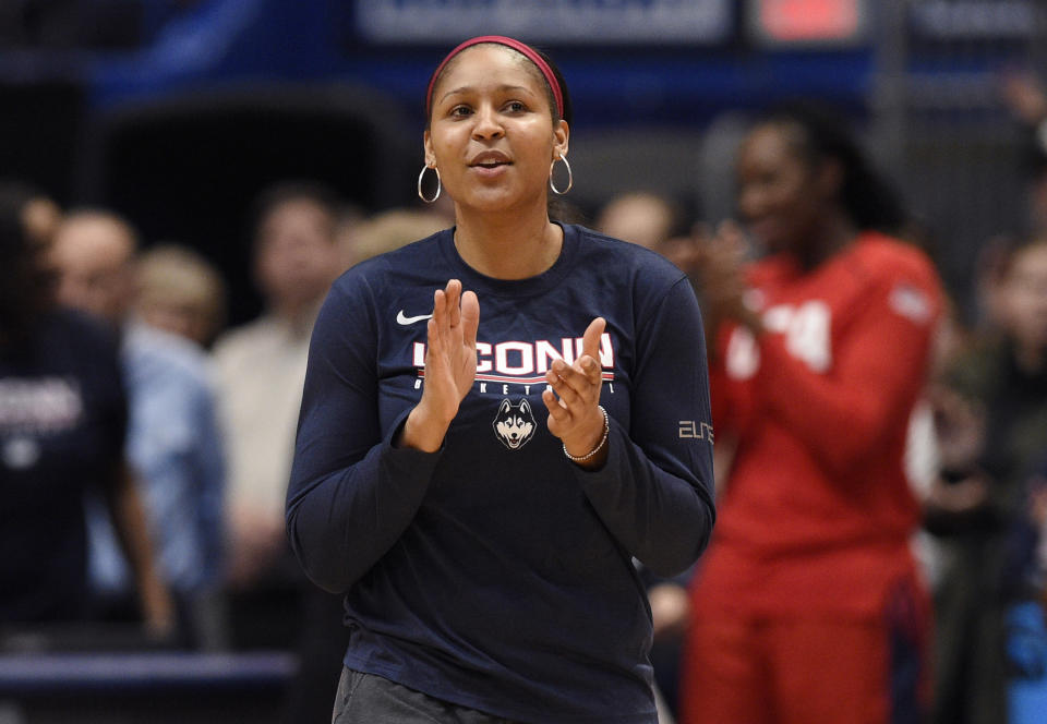 """FILE - In this Jan. 27, 2020, file photo, former Connecticut and Minnesota Lynx player Maya Moore applauds in Hartford, Conn. Moore left the WNBA in 2019 to help her now husband Jonathan Irons get his conviction overturned and win his release from prison. Moore, 32, remains non-committal to returning to the WNBA. A documentary of their story — """"Breakaway"""" — that was produced by Robin Roberts will air next week on ESPN. (AP Photo/Jessica Hill, File)"""