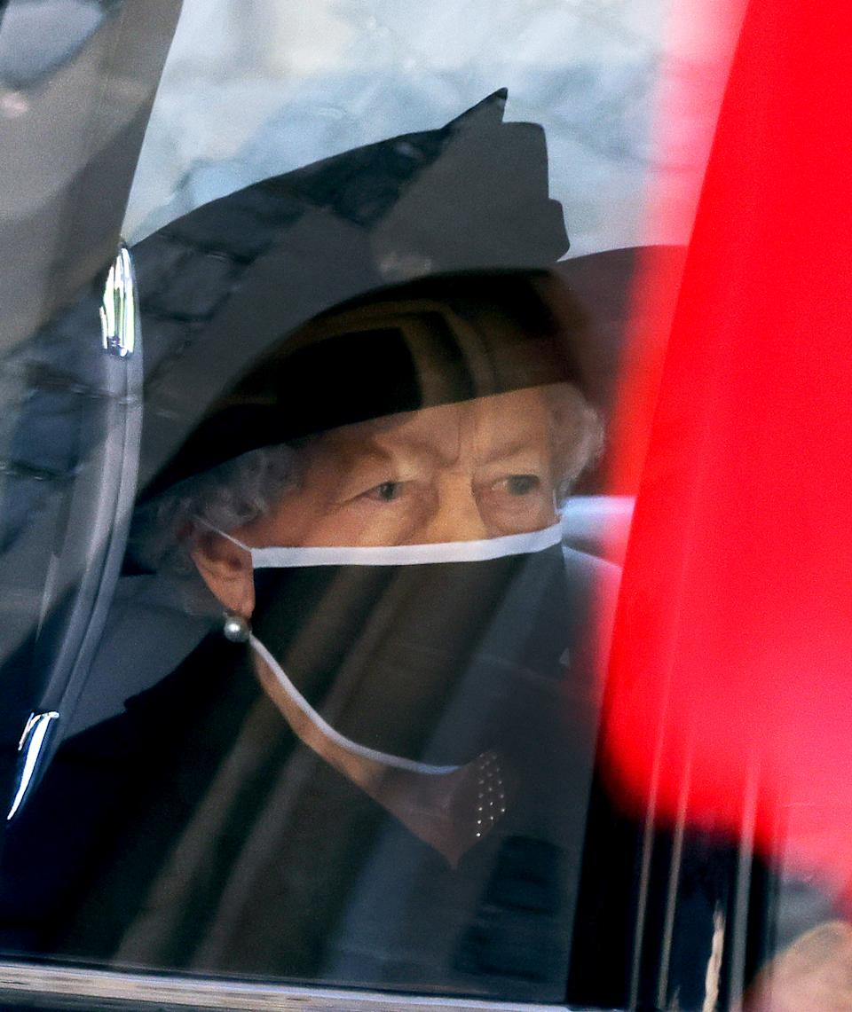 WINDSOR, ENGLAND - APRIL 17: Queen Elizabeth II arrives for the funeral of Britain's Prince Philip, Duke of Edinburgh at St George's Chapel at Windsor Castle on April 17, 2021 in Windsor, England. Prince Philip of Greece and Denmark was born 10 June 1921, in Greece. He served in the British Royal Navy and fought in WWII. He married the then Princess Elizabeth on 20 November 1947 and was created Duke of Edinburgh, Earl of Merioneth, and Baron Greenwich by King VI. He served as Prince Consort to Queen Elizabeth II until his death on April 9 2021, months short of his 100th birthday. His funeral takes place today at Windsor Castle with only 30 guests invited due to Coronavirus pandemic restrictions. on April 17, 2021 in Windsor, England. Prince Philip of Greece and Denmark was born 10 June 1921, in Greece. He served in the British Royal Navy and fought in WWII. He married the then Princess Elizabeth on 20 November 1947 and was created Duke of Edinburgh, Earl of Merioneth, and Baron Greenwich by King VI. He served as Prince Consort to Queen Elizabeth II until his death on April 9 2021, months short of his 100th birthday. His funeral takes place today at Windsor Castle with only 30 guests invited due to Coronavirus pandemic restrictions. (Photo by Jonathan Buckmaster - WPA Pool/Getty Images)