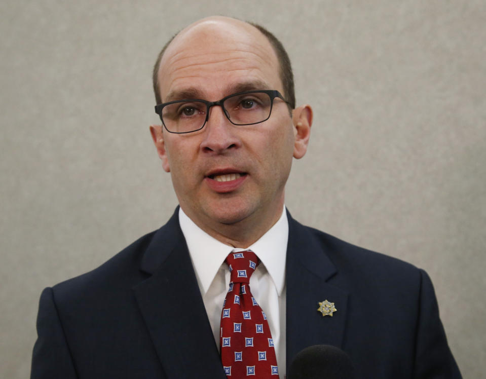 \ FILE - In this Friday, Dec. 15, 2017 file photo, Cleveland County District Attorney Greg Mashburn talks with the media in Norman, Okla. As many as ten death row inmates in Oklahoma, more than one-fifth of the state's prisoners condemned to die, could escape the death penalty because of a recent U.S. Supreme Court ruling about criminal jurisdiction in Indian Country. (AP Photo/Sue Ogrocki, File)