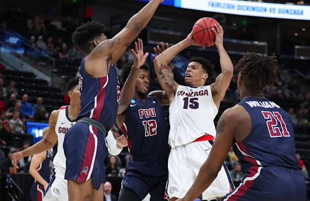<p>Brandon Clarke #15 of the Gonzaga Bulldogs goes up for a shot against Kaleb Bishop #12 of the Fairleigh Dickinson Knights during the first half in the first round of the 2019 NCAA Men's Basketball Tournament at Vivint Smart Home Arena on March 21, 2019 in Salt Lake City, Utah. </p>