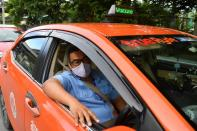 Thai taxi driver shows vaccination status on car to gain passengers' trust, in Bangkok