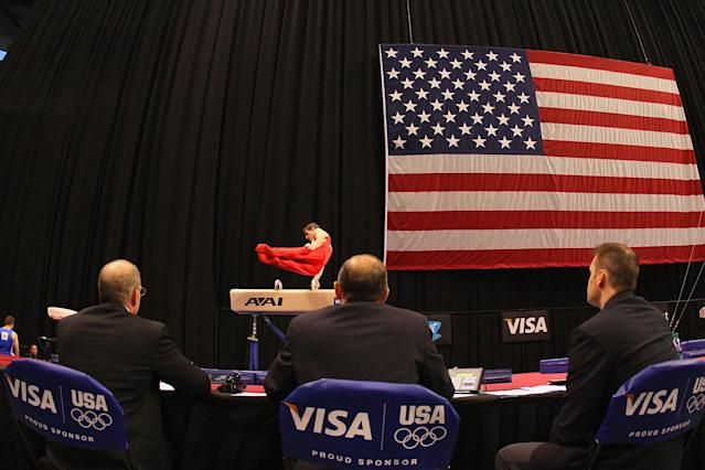 ST. LOUIS, MO - JUNE 7: Judges watch Eric Schryver compete on the pummel horse during the Senior Men's competition on day one of the Visa Championships at Chaifetz Arena on June 7, 2012 in St. Louis, Missouri. (Photo by Dilip Vishwanat/Getty Images)