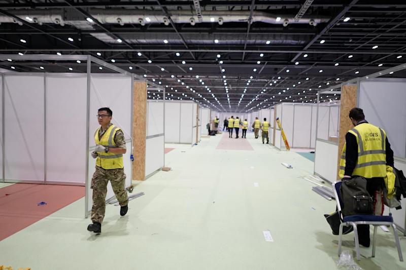 Work is underway to open a giant field hospital in London next week (PA)