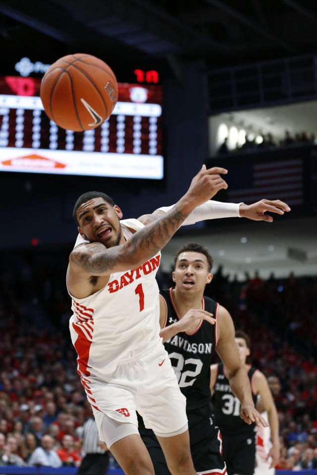 Dayton forward Obi Toppin (1) loses a pass in front of Davidson forward Nelson Boachie-Yiadom (32) during the first half of an NCAA college basketball game Friday, Feb. 28, 2020, in Dayton, Ohio. (AP Photo/Gary Landers)
