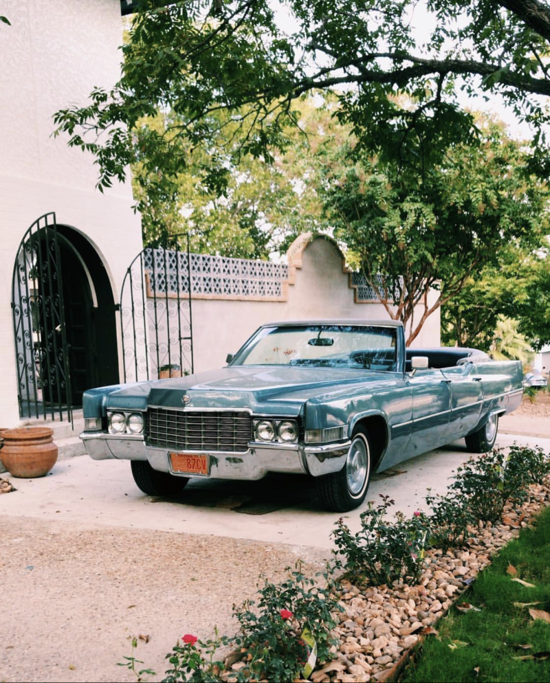 Guests can request to be picked up from the airport in a 1969 Cadillac limo convertible. Provided by Jantzen Matzdorff.