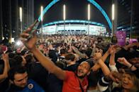 England fans celebrate outside Wembley Stadium after England qualified for the Euro 2020 final