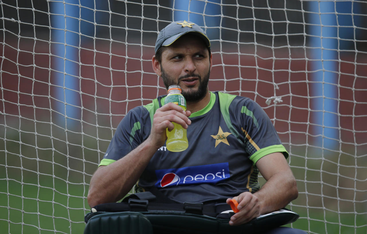 Pakistan's Shahid Afridi takes a break after batting in the nets during a training session ahead of their ICC Twenty20 Cricket World Cup match against India in Dhaka, Bangladesh, Thursday, March 20, 2014. (AP Photo/Aijaz Rahi)