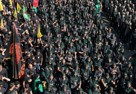 Lebanon's Hezbollah supporters chant slogans during last day of Ashura, in Beirut, Lebanon September 20, 2018. REUTERS/Aziz Taher