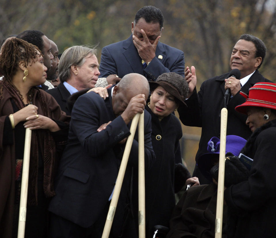 Rev. Jesse Jackson, top center, and Rep. John Lewis, D-Ga., leaning on shovel, become emotional as Amb. Andrew Young, top right, speaks about the significance of the late Dr. Martin Luther King Jr., during the breaking ground for the Martin Luther King Memorial on the National Mall in Washington Monday Nov. 13, 2006. Consoling Rep. Lewis are former Labor Secretary Alexis Herman, center, and fashion designer Tommy Hilfiger, second from left. At lower right, Martin Luther King Jr.'s sister Christine King Farris. (Photo: Lauren Victoria Burke/AP)