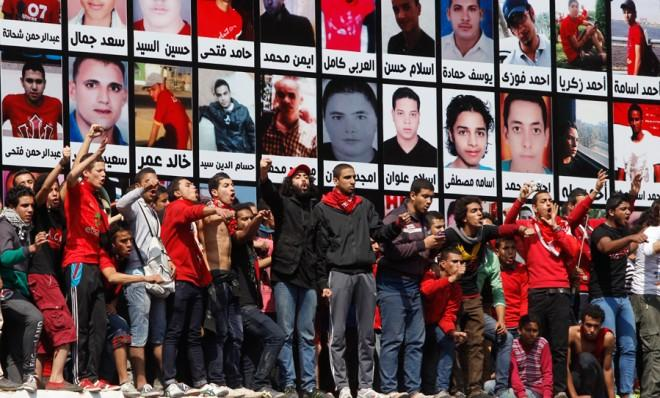 Hardcore football fans, known as Ultras, react to the Egyptian court's final verdict on March 9 confirming death sentences to 21 Ultras for their role in last year's stadium massacre.