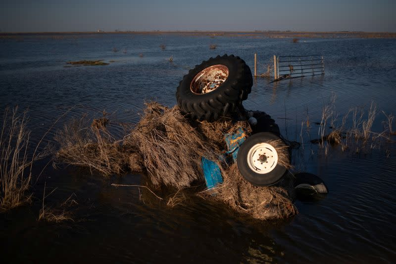 A tractor is seen submerged in flood waters in the aftermath of Hurricane Delta in Creole, Louisiana