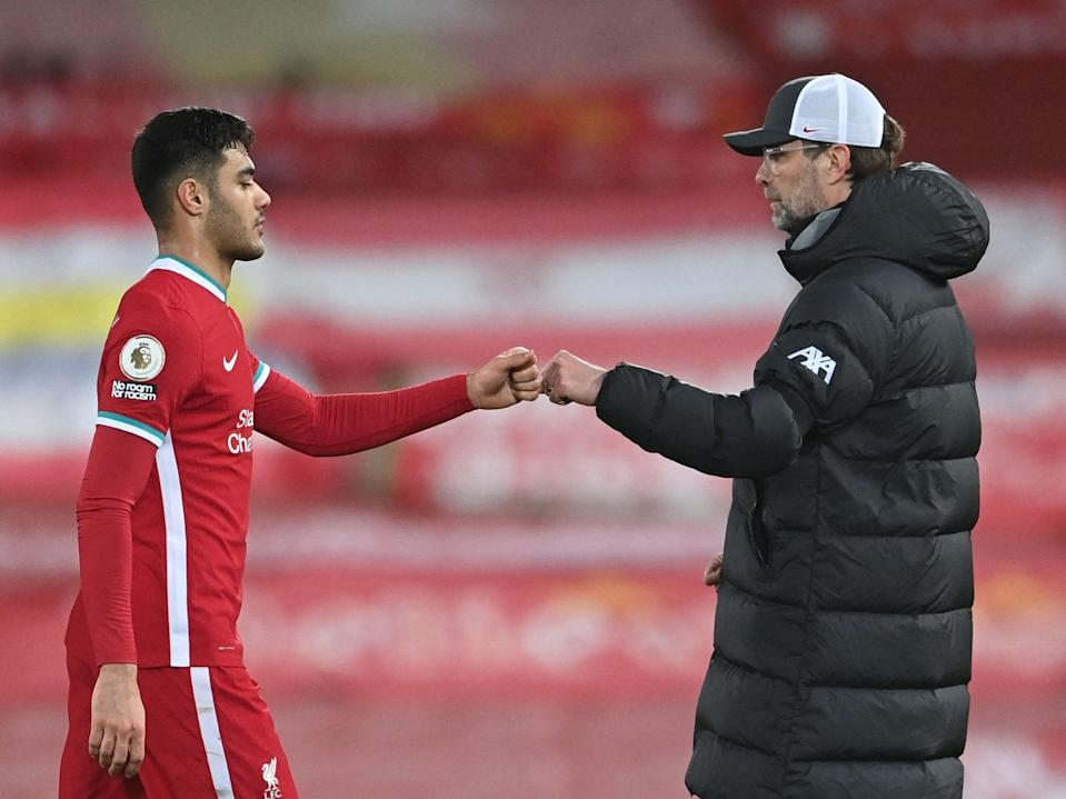 Liverpool manager Jurgen Klopp and defender Ozan Kabak (POOL/AFP via Getty Images)