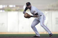 San Francisco Giants' Evan Longoria throws out Oakland Athletics' Matt Olson at first base during the first inning of a baseball game in San Francisco, Tuesday, Aug. 13, 2019. (AP Photo/Jeff Chiu)