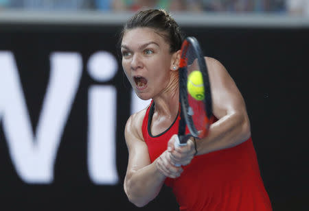 FILE PHOTO: Simona Halep of Romania hits a shot against Naomi Osaka of Japan. REUTERS/Issei Kato