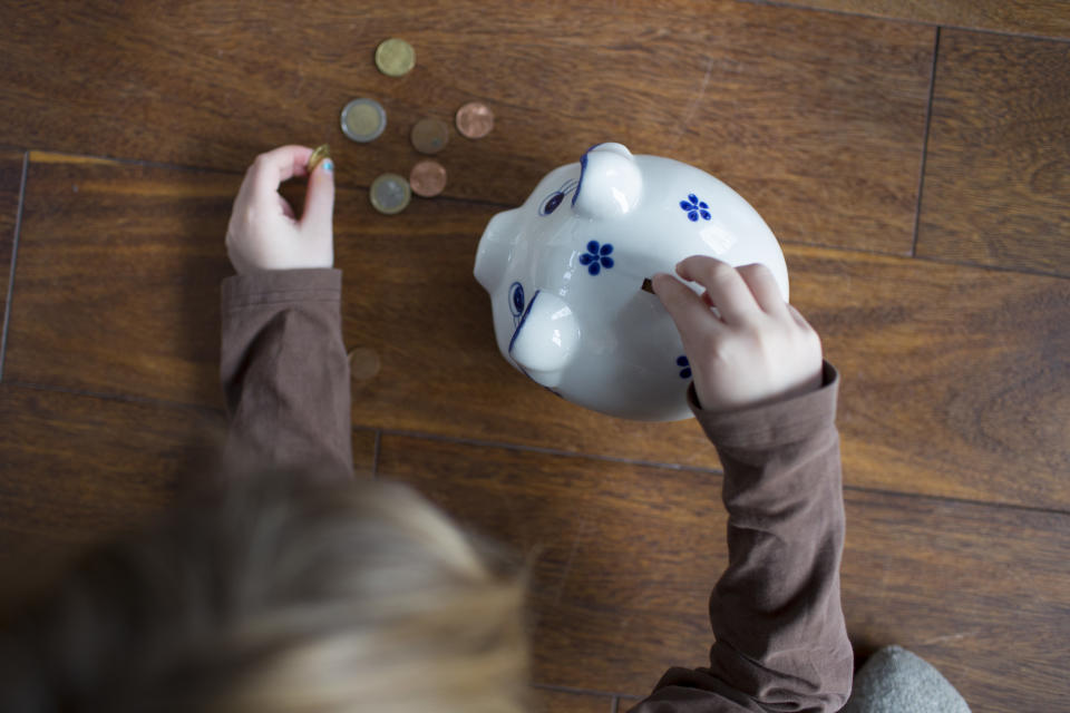 Bonn, Germany - February 03: Five-year old girl puts money in a money box on February 03, 2018 in Bonn, Germany. (Photo Illustration by Ute Grabowsky/Photothek via Getty Images)