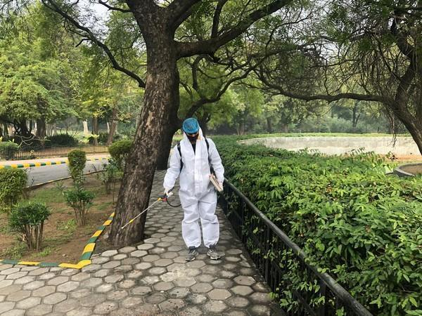 A zoo workers disinfecting the premises. (Photo/ANI)