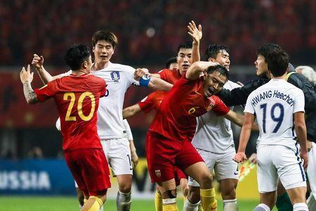 Football Soccer - China v South Korea - 2018 World Cup Qualifiers - Changsha, China - 23/3/17 - Players of both sides clash. REUTERS/Stringer
