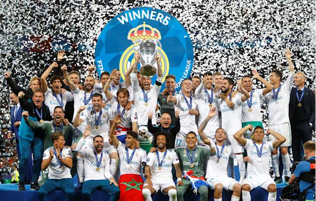 Soccer Football - Champions League Final - Real Madrid v Liverpool - NSC Olympic Stadium, Kiev, Ukraine - May 26, 2018 Real Madrid celebrate with the trophy after winning the Champions League REUTERS/Kai Pfaffenbach