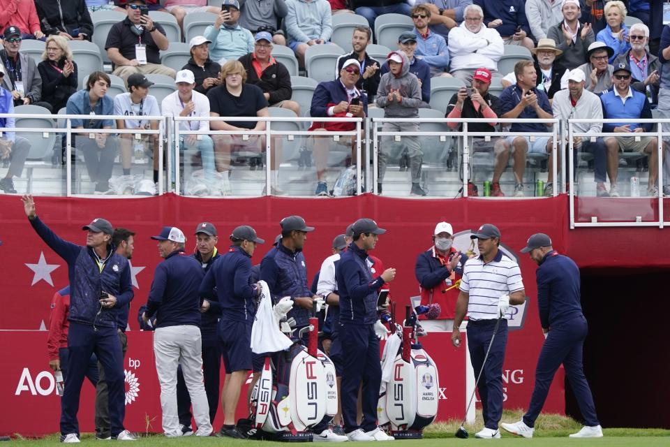 Team USA players wait to tee off on the first hole during a practice day at the Ryder Cup at the Whistling Straits Golf Course Tuesday, Sept. 21, 2021, in Sheboygan, Wis. (AP Photo/Charlie Neibergall)
