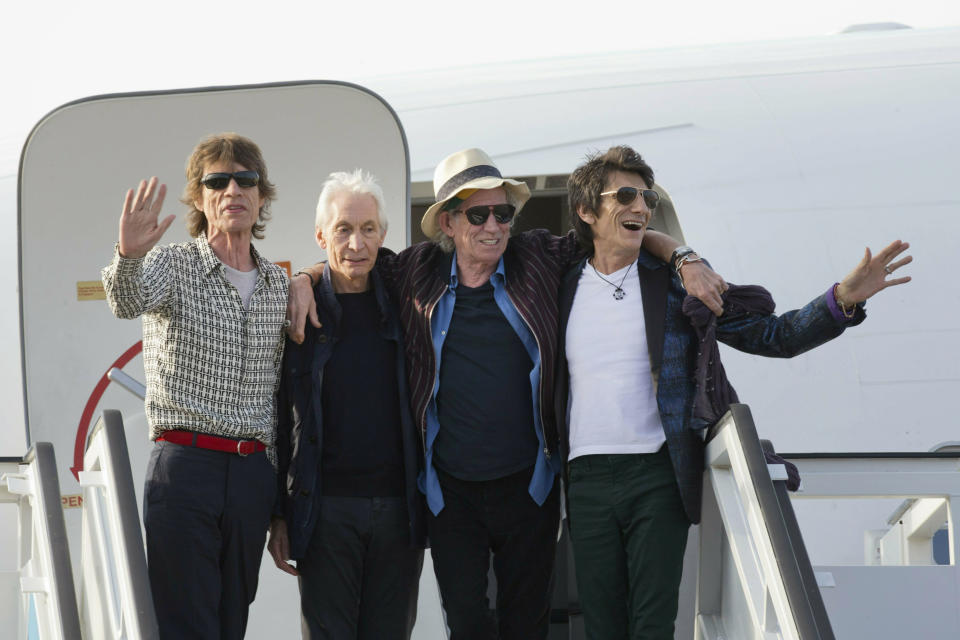 FILE - In this March 24, 2016 file photo, members of The Rolling Stones, from left, Mick Jagger, Charlie Watts, Keith Richards and Ron Wood pose for photos from their plane at Jose Marti international airport in Havana, Cuba. The Rolling Stones are threatening U.S. President Donald Trump with legal action for using their songs at his reelection campaign rallies despite cease-and-desist directives, according to a statement issued by the band Sunday June 28, 2020. (AP Photo/Ramon Espinosa File)