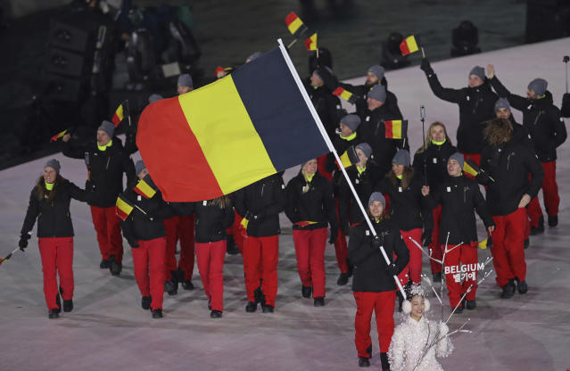 <p>Seppe Smits carries the flag of Belgium during the opening ceremony of the 2018 Winter Olympics in Pyeongchang, South Korea, Friday, Feb. 9, 2018. (AP Photo/Michael Sohn) </p>