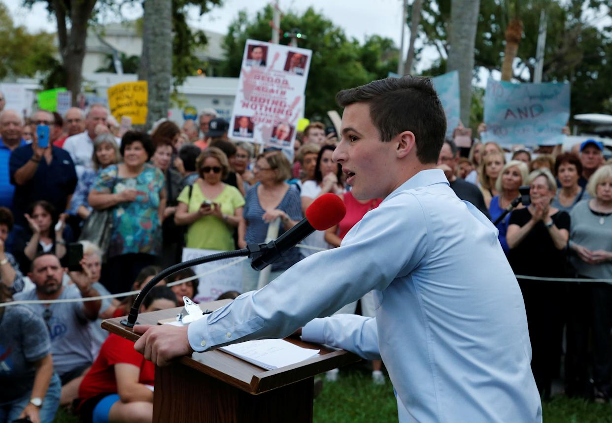 Cameron Kasky, a student at Marjory Stoneman Douglas High School, speaks to protesters at a Call To Action Against Gun Violence rally by the Interfaith Justice League and others in Delray Beach, Florida onFeb. 19, 2018. (Photo: Joe Skipper / Reuters)