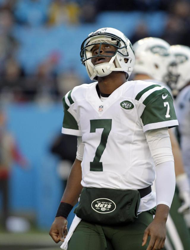 New York Jets quarterback Geno Smith (7) looks up after being sacked by the Carolina Panthers during the first half of an NFL football game in Charlotte, N.C., Sunday, Dec. 15, 2013. (AP Photo/Bob Leverone)