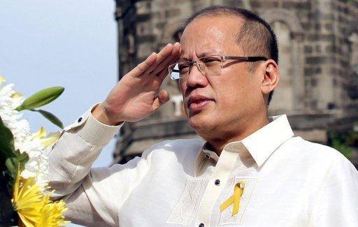 "This photo, released by the Malacanang Photo Bureau (MPB), shows Philippine President Benigno Aquino saluting during the flag raising and wreath laying ceremonies in commemoration of the 114th Philippine Independence Day at the Barasoain Church Historical Landmark in Malolos, Bulacan, in June. Aquino will deliver his annual ""state of the nation"" speech to Congress on Monday"