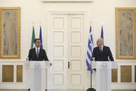 Greek Foreign Minister Nikos Dendias, right, speaks next to his Italian counterpart Luigi Di Maio during a news conference and after their meeting in Athens , on Tuesday, June 9, 2020. Greece will lift all restrictions on Italian tourists entering the country gradually between June 15 and the end of the month, Greece's foreign minister said Tuesday.(Costas Baltas /Pool via AP)