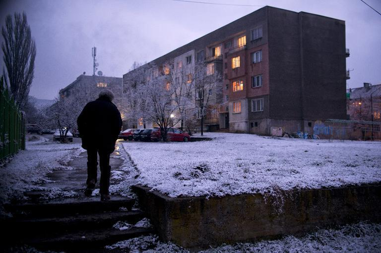 Mircho Koleshev, 60, walks home from a community centre where he works as a night guard in the town of Buhovo, near Sofia, on March 13, 2015