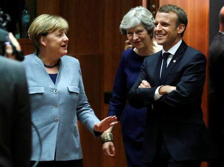 German Chancellor Angela Merkel (L) British Prime Minister Theresa May (C) and French President Emmanuel Macron arrive at the EU summit in Brussels, Belgium October 19, 2017. REUTERS/Yves Herman