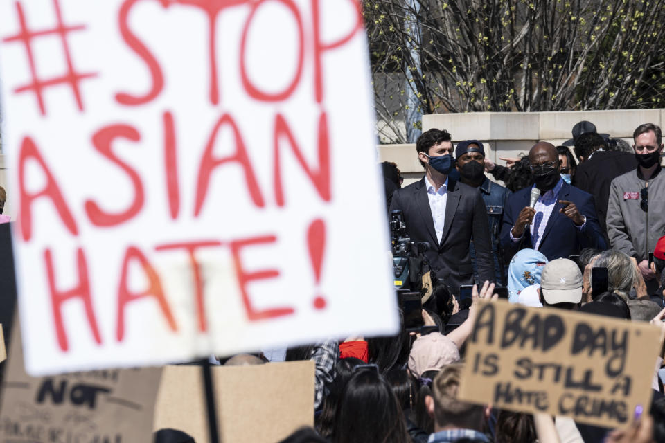 """FILE - This March 20, 2021, file photo shows, U.S. Sens. Jon Ossoff, D-Ga., and Raphael Warnock, D-Ga., speaking during a """"stop Asian hate"""" rally outside the Georgia State Capitol in Atlanta. A national coalition of civil rights groups will release on Wednesday, July 28, 2021, a comprehensive, state-by-state review of hate crime laws in the United States. Members of the coalition say the report sets the stage for bolstering the efficacy of current law and addresses racial disparities in how the laws are enforced. (AP Photo/Ben Gray, File)"""