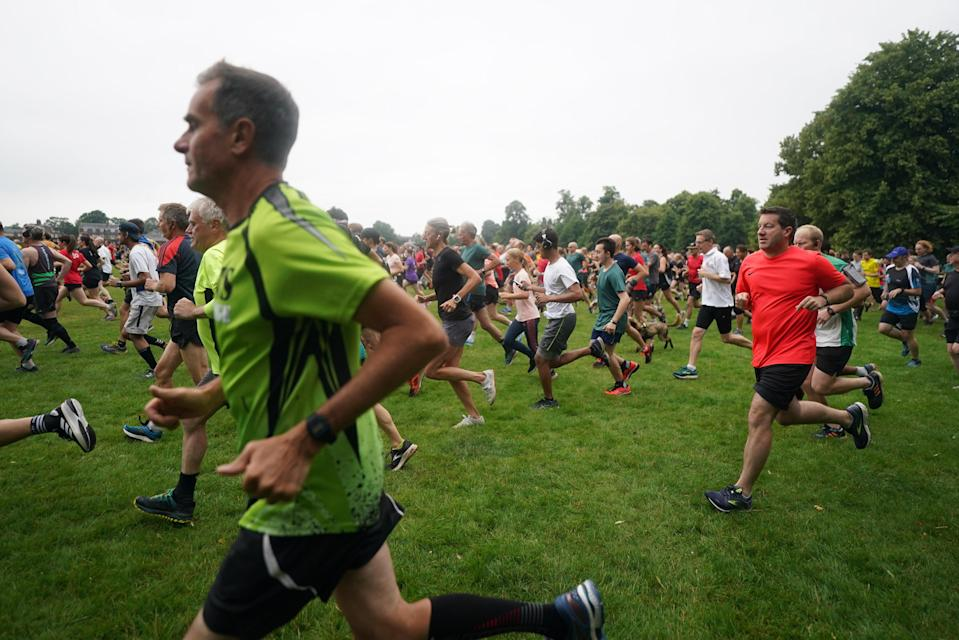 People take part in the Parkrun at Bushy Park in London, one of many runs taking place across the country for the first time since last March (Victoria Jones/PA) (PA Wire)