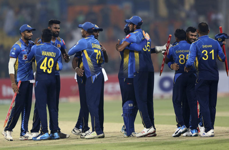 Sri Lankan players congratulate each other after the winning the first Twenty20 match against Pakistan at Gaddafi stadium in Lahore, Pakistan, Saturday, Oct. 5, 2019. (AP Photo/K.M. Chaudary)