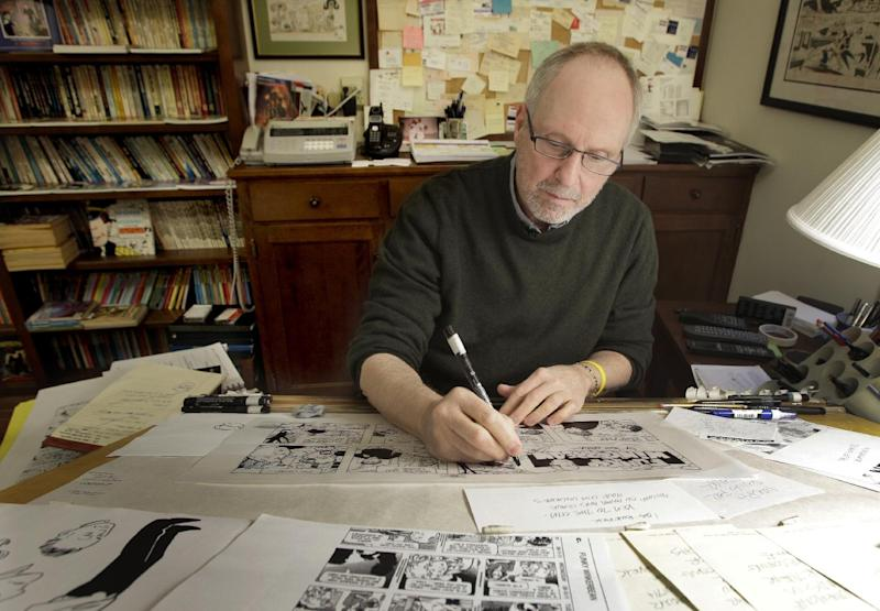 In this April 10, 2012 photo, cartoonist Tom Batiuk, creator of the comic strip Funky Winkerbean, inks a strip at the drawing table of his Medina, Ohio home studio. During its 40-year run on the funny pages, the characters and Batiuk have evolved and so have the story lines, from high school hijinks and awkward teen dating moments to dealing with adult issues like alcoholism, suicide and cancer. His latest hot topic story line during May: two boys who want to go to the high school prom together. (AP Photo/Amy Sancetta)