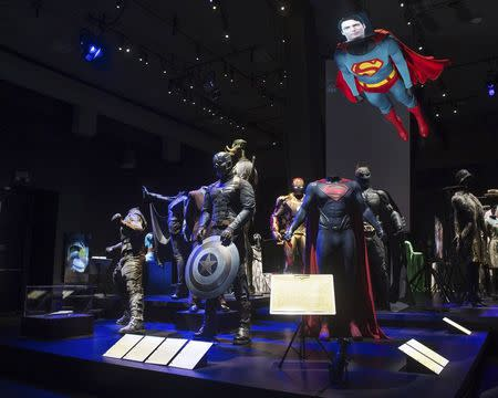 Superhero costumes are shown on display at the Hollywood Costume exhibit, curated by the Academy of Motion Pictures Arts and Sciences and London's Victoria & Albert museum, at the future home of the Academy Museum of Motion Pictures in Los Angeles, in this publicity photo released to Reuters on September 30, 2014. REUTERS/Greg Harbaugh/Copyright 2014 AMPAS/Handout via Reuters